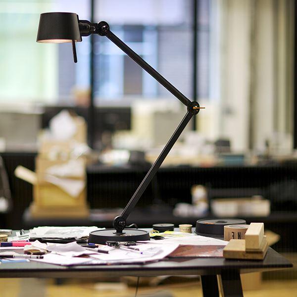 Tonone Bolt Double Arm on working desk lifestyle